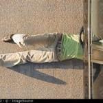 man under car